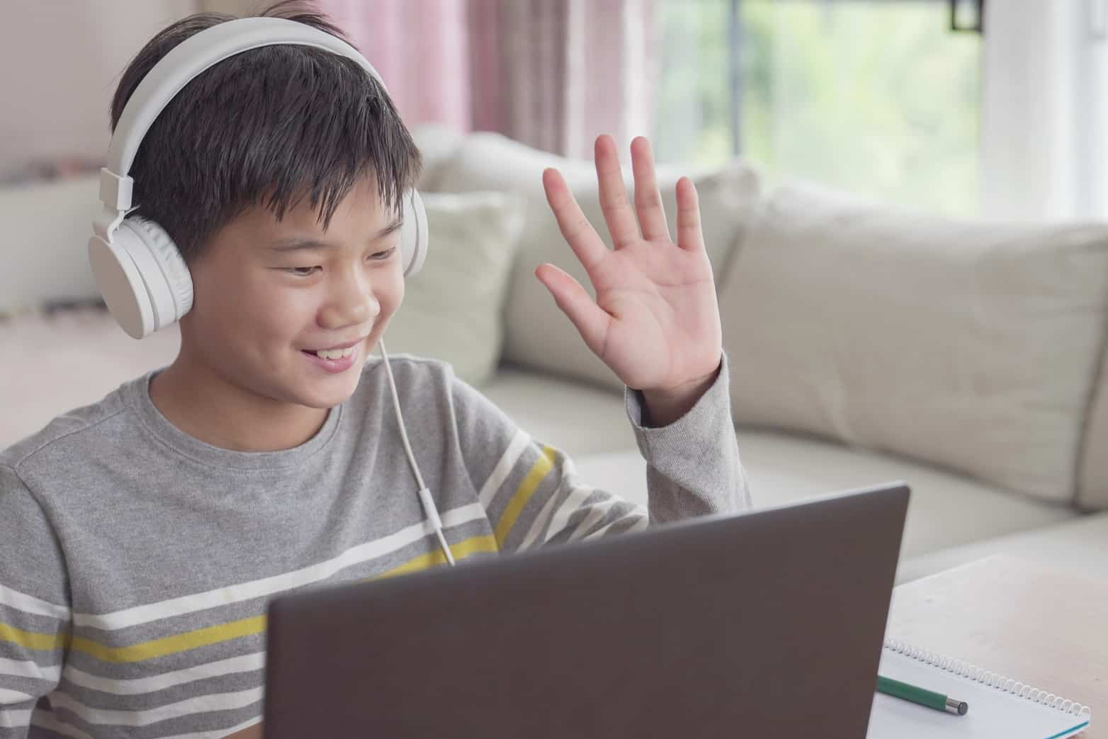 Elementary school boy having an online discussion during class.education, social distancing,homeschooling,learning remotely during covid-19 coronavirus, new