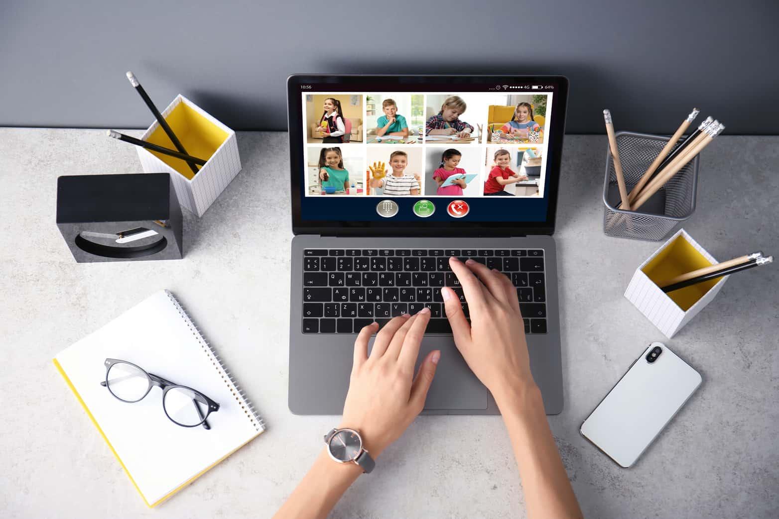 Teacher giving online school lesson via video conference