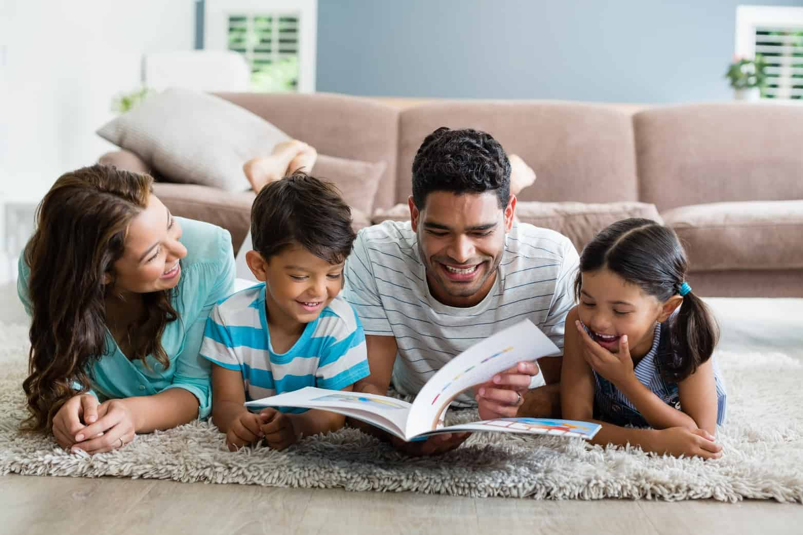 Family reading together as part of remote book club during remote learning