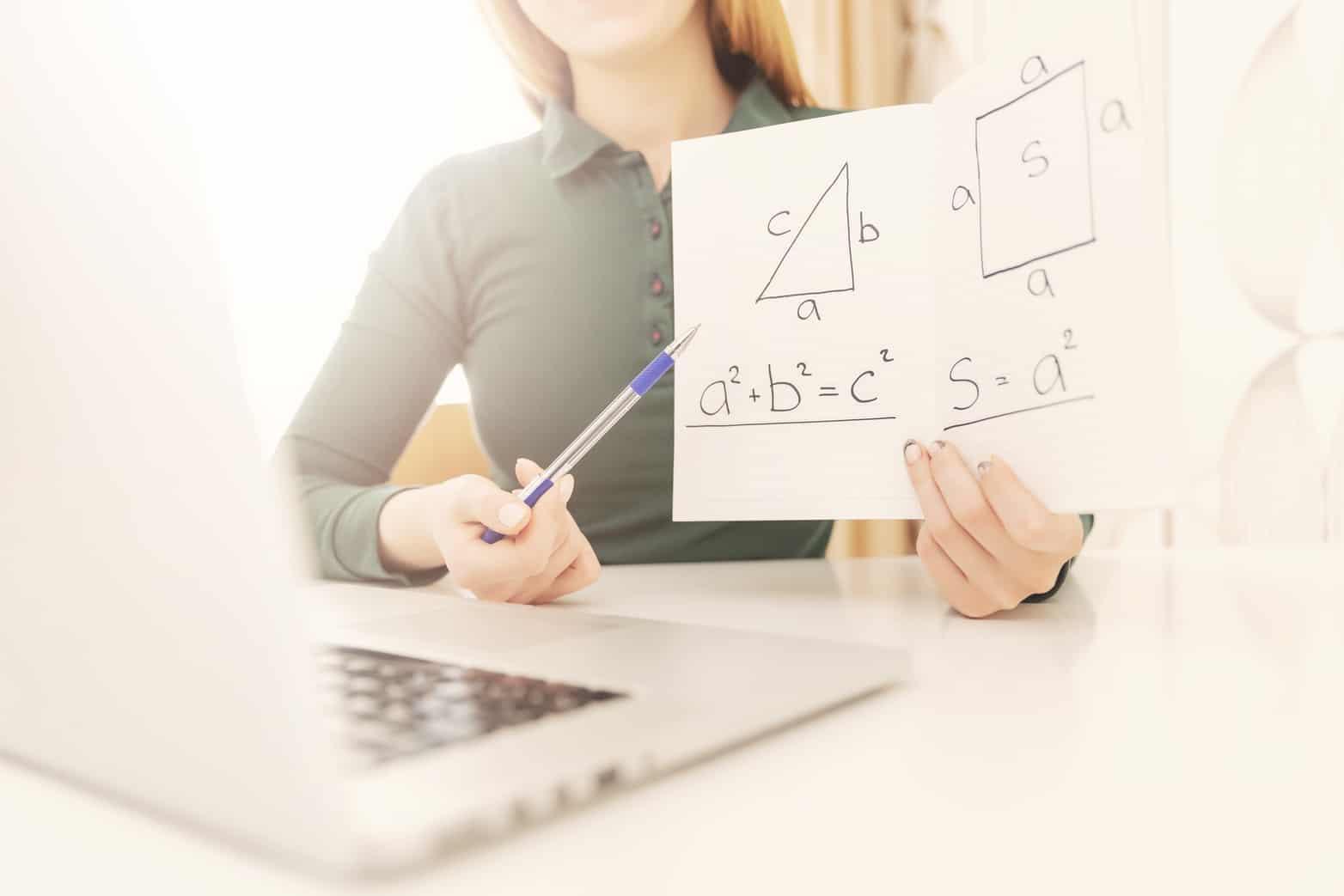 Math teacher explains online lesson to students